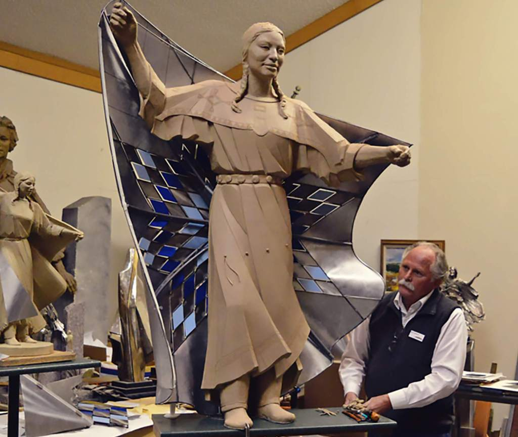 Sculptor Dale Lamphere with Life-sized model of Dignity