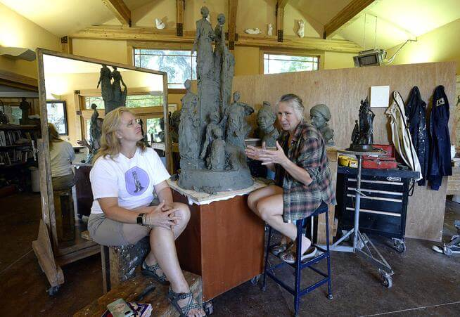 Sculptor Jane DeDecker discusses with Jody Shadduck-McNally placement of suffragette monument sculpture