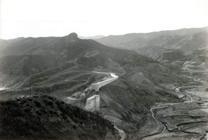 Overview of Dam & Reservoir After Break. EX-SAN FRANCISCO PUBLIC UTILITIES COMMISSION ARCHIVES. Photos of the St. Francis Dam disaster.