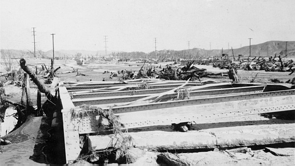 Contemporary photo postcard of the demolished bridge at Castaic Junction, shortly after the St. Francis Dam disaster.