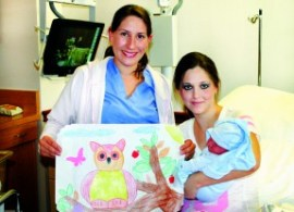 Patients Brittany Brooks and her newborn son Dolce Brooks enjoy one of the Valentine's Day themed placemats which was decorated by Ashley Spiller, 9, a student at James Foster Elementary School, and daughter of Angela Spiller (at left), an OB tech at Henry Mayo.