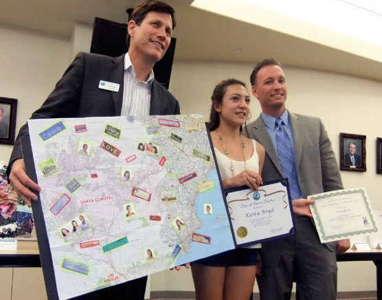 Keira Boyd of Placerita Junior High, with Arts Commissioner John Dow (left) and Santa Clarita City Manager Ken Striplin.