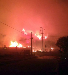 Photo shows the fire encroaching on the Lake Hughes community center.