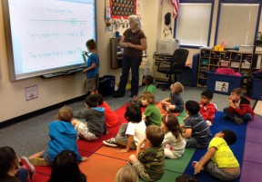 Rikki Fayne teaches her Golden Oak kindergarten class about the number line using a SMART Board. Photo: KHTS