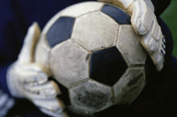 soccer ball in goalie's hands