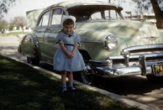 My sweet little aunt (one of 14 kids) poses in front of her Glendale home in 1954, wearing one of many dresses hand-made by her mother.
