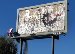 Dilapidated billboard spotted Friday in downtown Newhall, right next to $100,000 in Christmas lights.