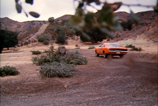 "The General Lee tears through ""Cottonwood Corners"" in Season 5, Episode 7 of the CBS television series, ""The Dukes of Hazzard."" Episode title: ""Vance's Lady,"" original air date November 5, 1982.  Click image for more."