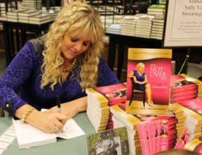 """Sally Van Swearingen, author of """"It's Not Over Yet!: Reclaiming Your Real Beauty Power in Your 40s, 50s and Beyond,"""" signed dozens of copies of her book at the event. Photo by Michele E. Buttelman"""