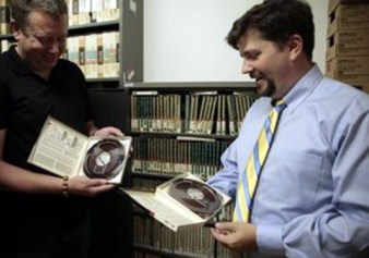Archivist Derek Bolin (left) and Tim Groeling, chair of the UCLA Department of Communication Studies. Photo: UCLA