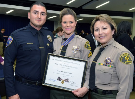 Deputy Underwood-Nunez (center) with her husband Fidel Nunez, a Realto police officer, and Capt. Maria Gutierrez of the Sheriff's Century Regional Detention Facility.