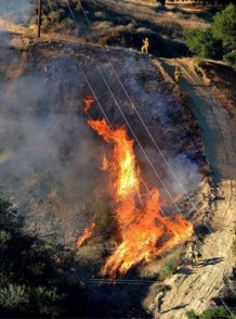 Crews are still working to contain the Calgrove fire Thursday. Photo: LACo Fire