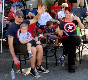 Mikee Schwinn, left, celebrates the Fourth of July 2015 in front of his theater.