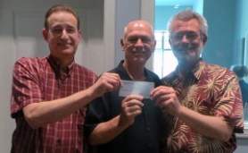 Historical Society president Alan Pollack (left) and treasurer Duane Harte (center) receive a check from Leon Worden. Harte, 2003's Man of the Year, also serves as treasurer of the SCV Man & Woman of the Year committee.