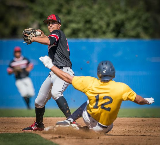 Chaffey College second baseman Evan Rice forces out College of the Canyons' Calvin Estrada at second base as he starts his throw to first. Rice's throw was wide and the batter was safe during the second inning Saturday, February 17, 2018. Photo: Kevin Karzin.