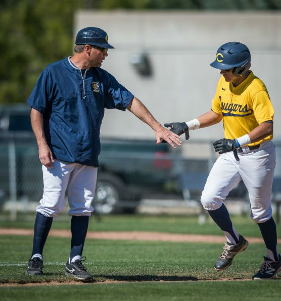 College of the Canyons Eddie Rodriguez (right) is congratulated by head coach Chris Cota after hitting a solo home run in the third inning Saturday, February 17, 218 against Chaffey College at College of the Canyons. Photo: Kevin Karzin.