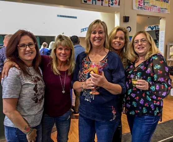 Varsity Parent Lee Coogan celebrates her birthday with friends at Hart Bingo Night.