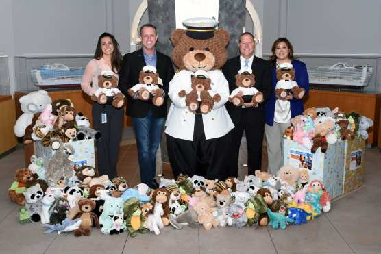 Princess Cruises delivers donation of plush animals to Henry Mayo Newhall Hospital as part of the 2018 Teddy Bear Drive. Pictured from left to right: Kelly O'Keefe (Supervisor, Cruise Vacation Planning Support, Princess Cruises), Brian O'Connor (Vice President, Public Relations, Princess Cruises), Stanley the Bear (life-size character), Dustin Ashenfelter (Director, Emergency and Trauma Services, Henry Mayo Newhall Hospital), Renée León (Donor Relations Officer, Henry Mayo Newhall Hospital Foundation).