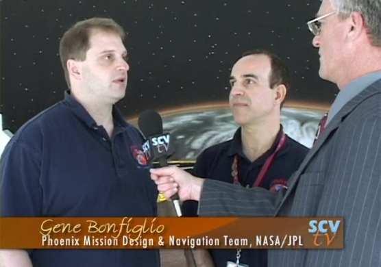 Gene Bonfiglio speaks with SCVTV's Leon Worden about the Phoenix Mission, as Behzad Raofi looks on.