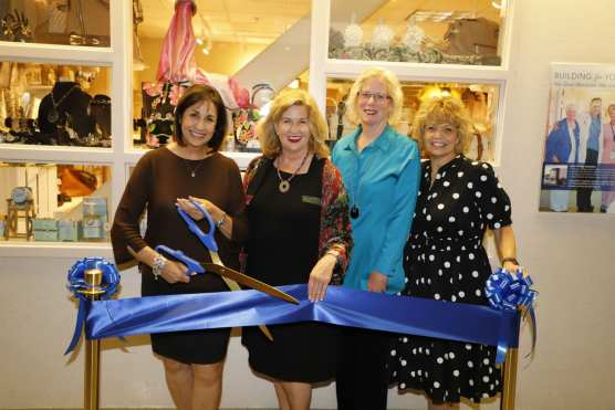 Cutting the ribbon to dedicate the remodeled gift shop at Henry Mayo Newhall Hospital are (from left) Geri Jacobs, Marlee Lauffer, Sue Nevius and Kathy Gilbert.