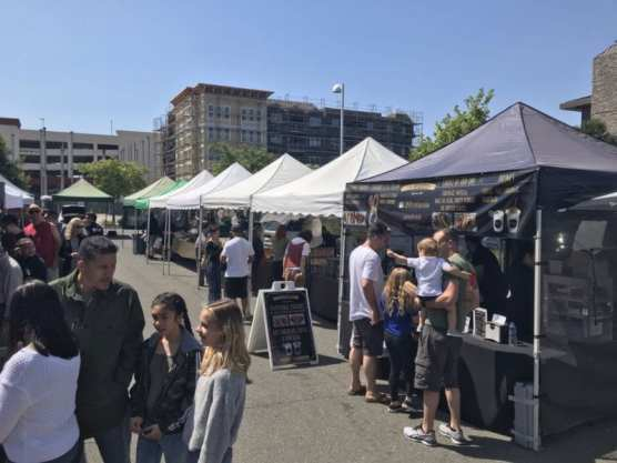 A crowd grows between the vendors at the Old Town Newhall Farmers Market, which celebrated its fourth anniversary Saturday.   Photo: Ryan Mancini/The Signal.