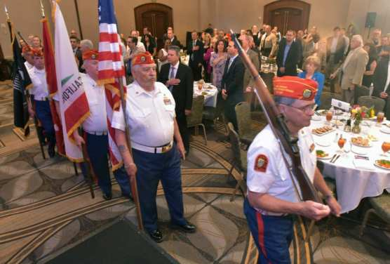 Fausto Galvan's Marine Corps Color Guard marches in with the colors during the 9th Annual Patriots Luncheon presented by The Santa Clarita Valley Chamber of Commerce and the City of Santa Clarita at the Hyatt Regency Valencia on Thursday. | Photo: Dan Watson/The Signal.