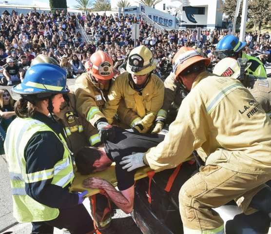 "First responders remove the ""dead body"" of Saugus High School senior Jared Zimmerman representing the victim in a drunk driving, head-on collision during the ""Every 15 Minutes"" event held at Saugus High School on Thursday, November 7, 2019. 
