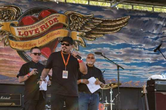 Emilio Rivera, Grand marshal and star of the FX series, Mayan M.C. joins Robert Patrick, Owner of Harley Davidson of Santa Clarita, and Oliver Shokouh, creator of the LoveRide and owner of Harley Davidson of Glendale, on stage to kick off the musical entertainment and thank those who ride to support the cause at the 33rd Love Ride, hosted by Harley Davidson store of Santa Clarita and Glendale, Sunday, Nov. 10, 2019. | Photo: Gilbert Bernal / The Signal.