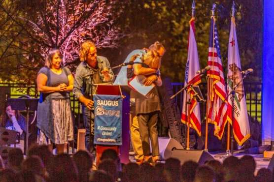 William S. Hart School District Superintendent Vicki Engbrecht embraces Saugus High School Principal Vince Ferry at the Saugus Strong Vigil Sunday night.   Photo: Cory Rubin / The Signal.