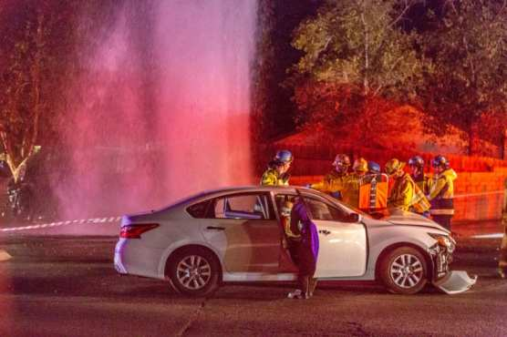 Firefighters and EMTs treat a woman involved in a two-car crash on the corner of Whites Canyon Road and Ashboro Thursday night.   Photo: Cory Rubin/The Signal.