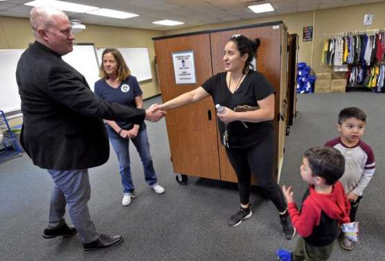 Newhall School District Superintendent Jeff Pelzel, left, and District Coordinator of Special Programs, Sarah Johnson, welcome Maria Velez and her three sons as they are the first family to visit the Wiley Canyon Elementary School Family Resource Center in Newhall on Thursday, November 21, 2019. | Photo: Dan Watson / The Signal.