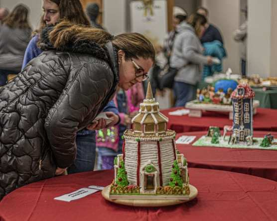 Leslie Babikan evaluates one of the entries in the College of the Canyons Gingerbread House Display and Competition held in the school's Culinary Arts building Wednesday night, December 4, 2019. | Photo: Bobby Block / The Signal.