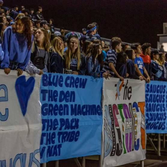 Saugus students join students from West Ranch in the student section at Valencia High School for a playoff matchup between the Wildcats and Wilson. | Photo: Cory Rubin / The Signal.