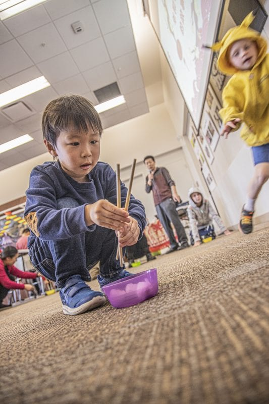 Dax Seki, age 4, participates in a chopstick relay race at the SCV Chinese School's Chinese New Year celebration at the Newhall Library on Saturday, January 18, 2020.   Photo: Bobby Block / The Signal.
