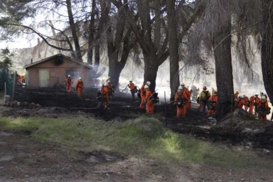 structure fire - Los Angeles County Fire Department camp crews assist with cleanup after a structure fire spread to the surrounding brush on the 9900 block of Soledad Canyon Road in Canyon Country on Monday, March 2, 2020. | Photo: Gilbert Bernal / The Signal.