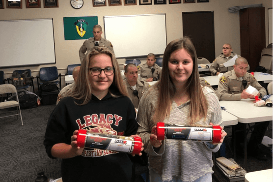 Maci and Cambria Lawrence with save the pressure kits