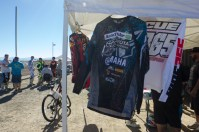 Justin talks to his friends while attendees bid on racing jerseys and other silent auction items at the Justin Covarrubias Ride Day at the AV Motoplex in Palmdale.