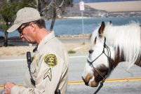 Santana and Deputy Bausmith get ready to start their first patrol of the day. The unit patrols all 150 parks in Los Angeles County on a day-to-day basis.