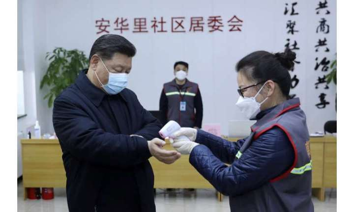 China's daily death toll from virus tops 100 for first time