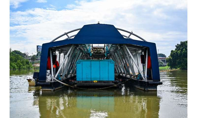 The Interceptor barge can collect up to 50 tons of waste per day.