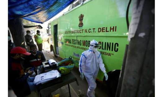 India's virus cases cross 10 million as new infections dip