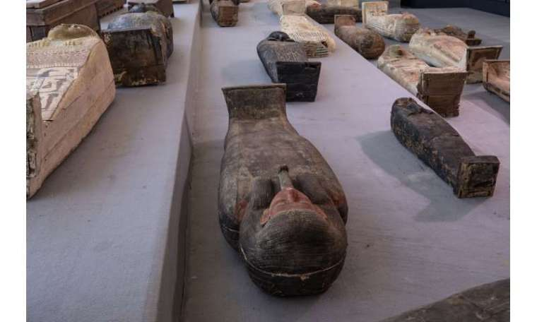 Egypt unveils ancient coffins and statues found at Saqqara