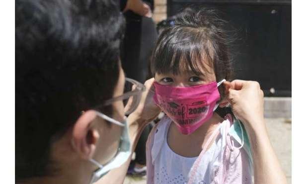 Virus spread, not politics should guide schools, doctors say