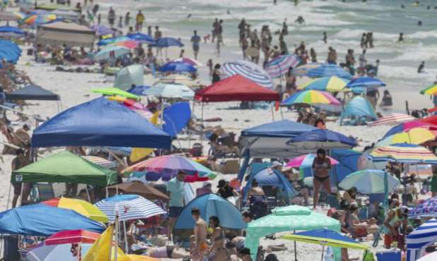 Americans and Europeans soak up the sun amid new rules