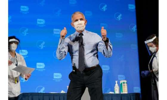 Anthony Fauci, director of the National Institute of Allergy and Infectious Diseases, gesticulates after receiving the first dose