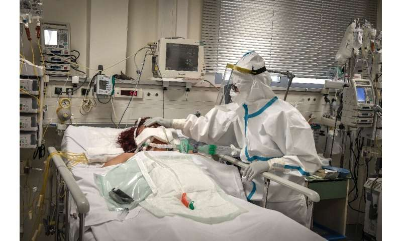 A nurse attends to a patient suffering from Covid-19 in an Athens suburb on November 20, 2020