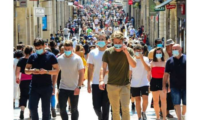 People stroll down Bordeaux's main shopping street Sainte-Catherine, where wearing a mask is compulsory as of August 15, 2020, t