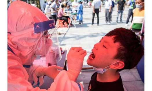 China's worst surge of coronavirus infections in months has spread to 14 provinces