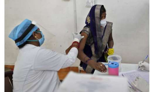 India launches effort to inoculate all adults against COVID
