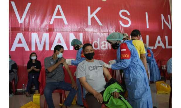 Indonesia caught between surge and slow vaccine rollout